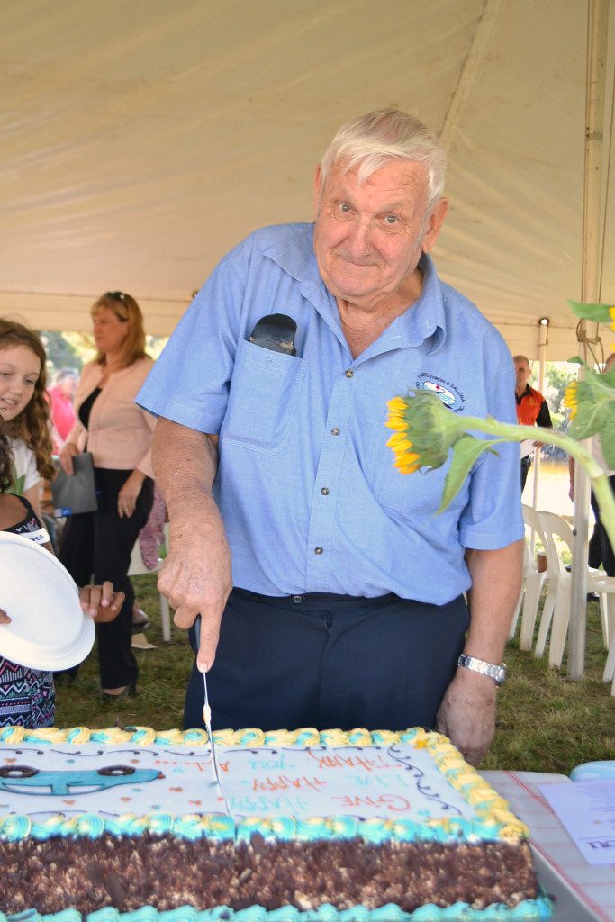 Ray, our volunteer president, cutting the cake.