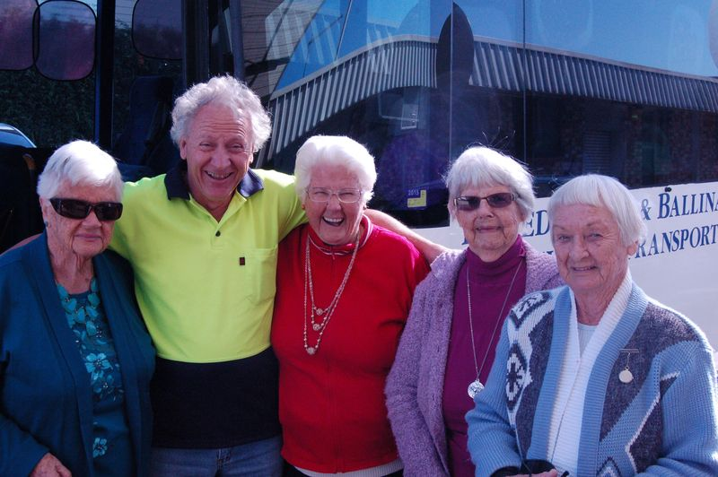Driver Grahame with a happy group of shopping bus passengers